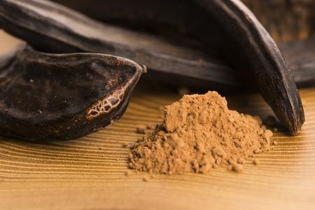 carob: carob pods and carob powder
