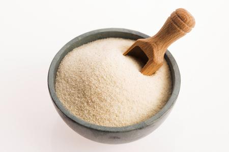 Bowl of semolina isolated on white 版權商用圖片