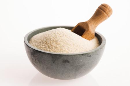 semolina: Bowl of semolina isolated on white Stock Photo
