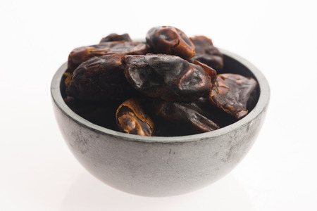 deglet: Dried dates fruit in a bowl Stock Photo