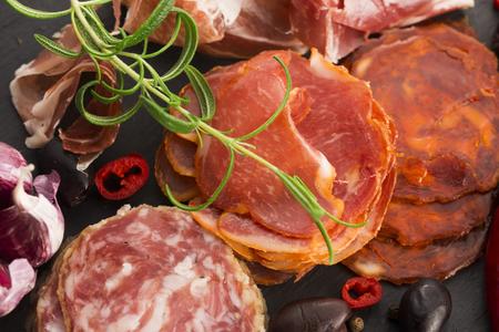 hams: a pile of different spanish embutido, jamon, chorizo and lomo embuchado