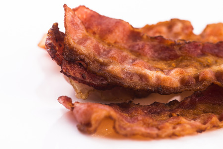 meaty: Cooked Bacon Strips Stock Photo