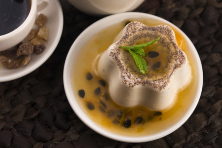 Panna cotta dessert with passion fruit and mint Stock Photo