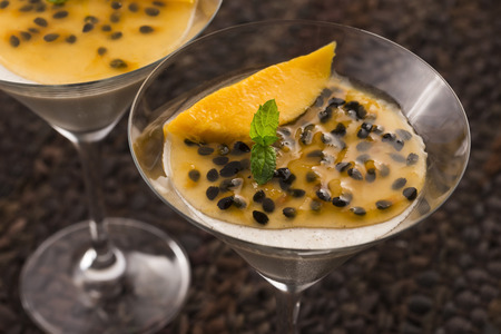 pannacotta: Panna cotta dessert with passion fruit and mint Stock Photo