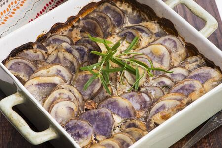 Violet potato gratin with cream and rosemary