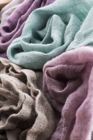 Multicolored textile with violet tones and colorful accents and rich, detailed texture, flax