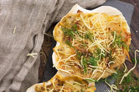 Baked scallops with cheese and spicy sauce. Delicate is a real pleasure.