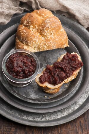 Sweet bread (challah) with cherry jam