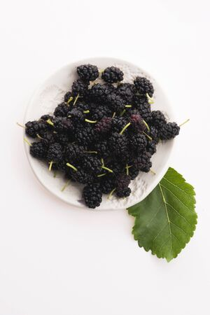 Pile of mulberry isolated on white plate