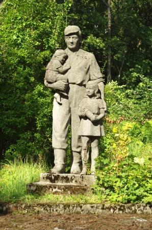 sanitarium: A figure of a miner with children next to the closed child sanitarium in Wisla, Poland  Artist unknown  Stock Photo