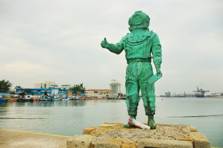 diver statue on a pier in Veracruz, Mexico  photo