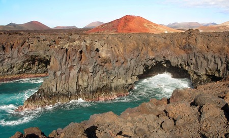 los hervideros: Los Hervideros, streams of volcanic lava pouring into sea, Lanzarote, Canary Islands