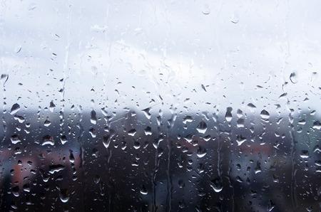 Rain drops on a window glass on a rainy day Stock Photo