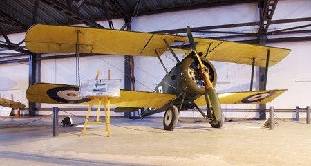 an old wooden biplane in a museum Editorial