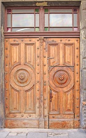 Heavy old gate door made of wood