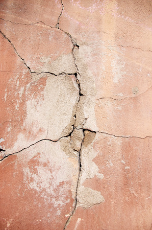 background texture of a cracked grunge wall Stock Photo