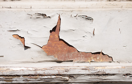 white cracked paint peeling off a wooden board Stock Photo