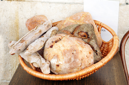 Basket full of Italian bread rolls on a table