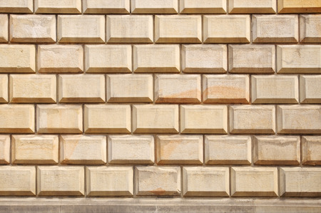 background texture of a convex brick wall