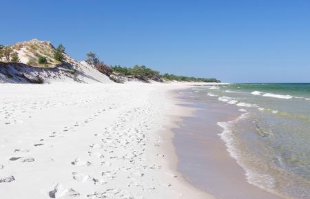empty sand beach with wild dunes, Hel, Poland Stock Photo