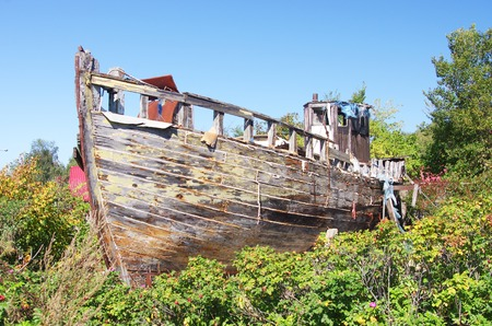 smack: an old wooden fishing smack wreck hull Stock Photo