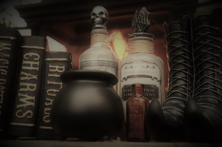 Halloween witch boots, cauldron, poison bottles lining a shelf