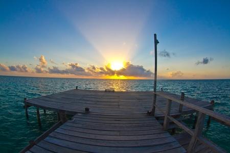 jetty at sunrise, caye caulker, belize