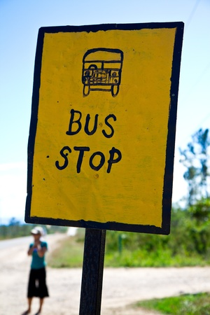A lonely figure waits for the weekly bus in Belize. photo