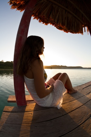 A young woman reflects upon the sunrise photo