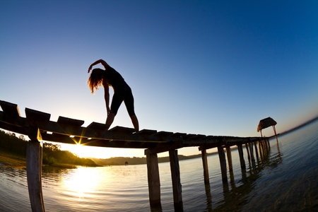 A young woman completes her exercises early morning Stock Photo - 9115821
