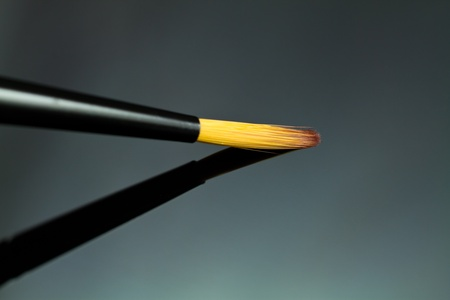 Close up of an artists paint brush. photo