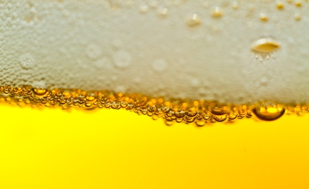 Super close up of the bubbles in beer with plenty of copy space. Stock Photo - 12032954