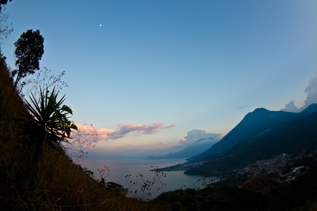 The sun setting over the mountains in lake Atitlan  san Pedro Guatemala. Stock Photo - 13246930