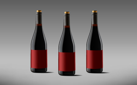 Composition of bottles. Bottles of wine on a gray background.