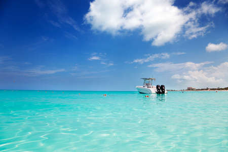 anchored: Speedboat anchored in the calm shallows of Grace Bay, Turks & Caicos Stock Photo