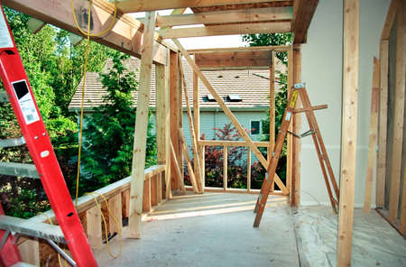 roof framing: Home remodeling - framing extension to master bedroom. Note: scanned from 35mm film