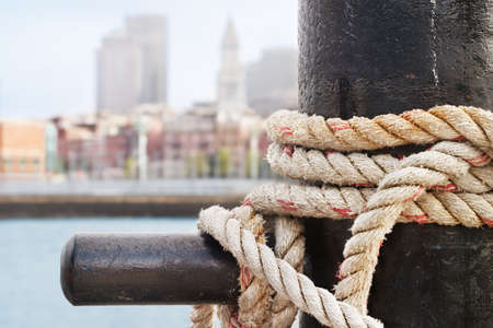 Heavy ropes secure a ship on the Charlestown side of Boston Harbor photo