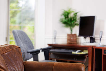 Comfy leather chair in a home office. Shallow depth of field. Stock Photo - 9692084