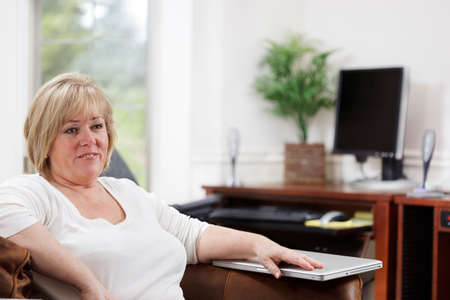 Mature woman relaxed while working at home Stock Photo - 9692090