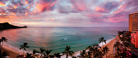 Waikiki Beach, Hawaii, as dawn lights up the clouds photo