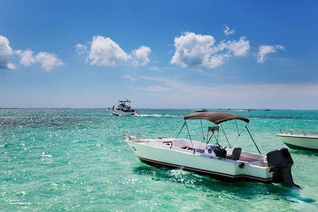 sandbar: Boats anchored by the sandbar at Stringray City, Grand Cayman