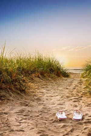 flops: Flip flops on the sandy boardwalk over the dunes
