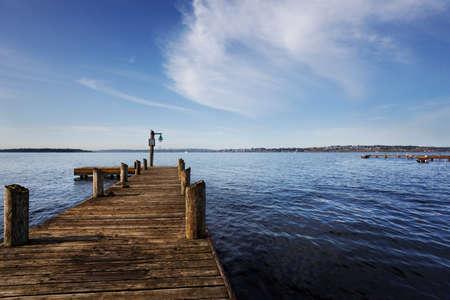 Public dock at Marine Point, Kirkland, Lake Washington, on a sunny Spring morning photo
