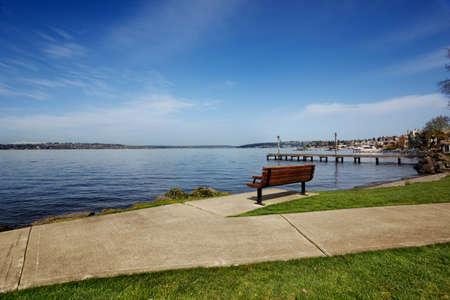 Bench facing towards Kirkland at a lakeside park on Lake Washington Stock Photo - 9776953