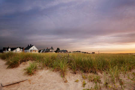 Maine beach houses in the first light of day photo