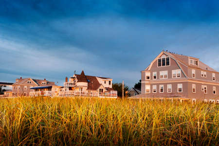 Closer view of Maine beach houses in morning sun photo