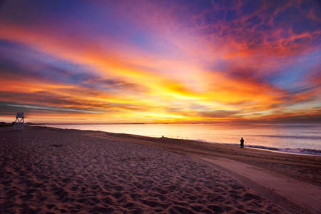 Vivid colors of dawn over the ocean in Maine on a summer morning Stock Photo