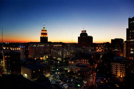 San Antonio downtown just after sunset showing skyline around Tower Life building photo