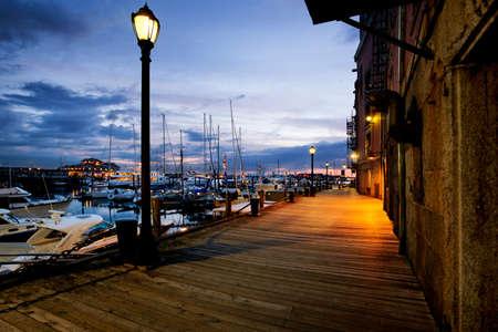 Pre-dawn light on the Boston harbor walk by Long Wharf Stock Photo - 9787814
