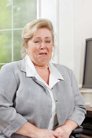 Mature woman loses it and burst into tears photo